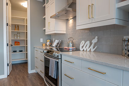 Kitchen with Walk-in Pantry - Show Home - RidgeWood West | Avanti Custom Homes - Home Builder - Winnipeg - Manitoba